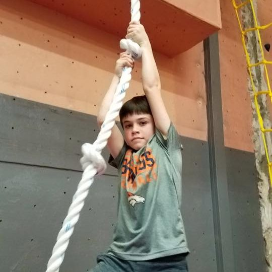 kid climbing rope ninja warrior class